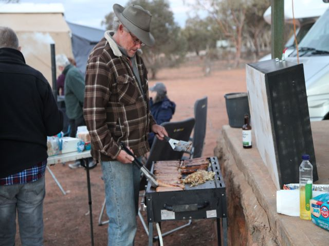 Cooking a sausage sizzle